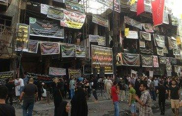 ابراز همبستگی مردم عراق در مراسم عزاداری قربانیان الکراده