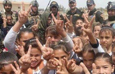 أهالي الرمادي يعودون إليها بعد هزيمة داعش