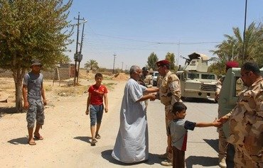 Iraqi forces free Anbar families from ISIL siege
