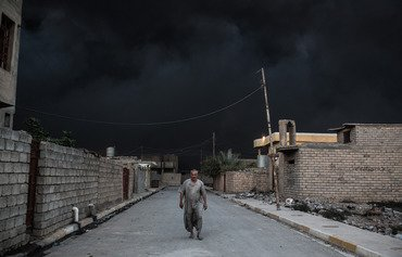 ISIL oil fires extend suffering of liberated Iraqi civilians