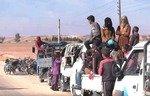 سكان الرقة يهربون مع اقتراب معركة تحريرها