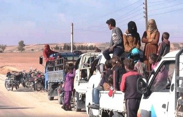 Al-Raqa residents flee as liberation battle looms