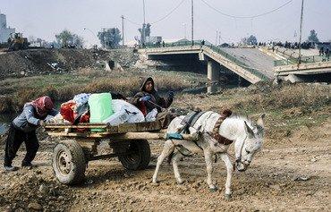 مردم غرب موصل با صرف روزی یک وعده غذا، خود را برای شرایط بدتر آماده می کنند
