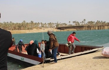 Hundreds of families return to western Anbar