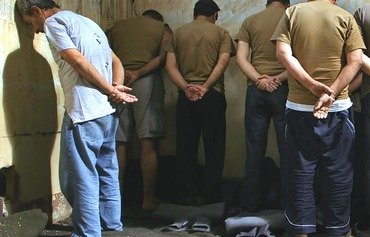Former inmates tell of torture in Syria prisons