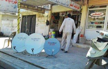 سكان الموصل يتهافتون على اقتناء أطباق الأقمار الصناعية بعد إطاحة داعش