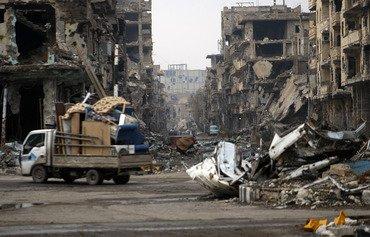 ميليشيات موالية للنظام تنهب المنازل في دير الزور