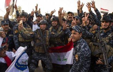 عراقی ها «پیروزی تاریخی» بر تروریسم در موصل را جشن گرفتند