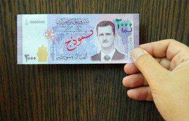 اسکناس هایی که تصویر الاسد برروی آن بود به برانگیختن تحریم ها منجر شد
