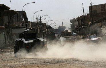 القوات العراقية تلاحق الفارين من عناصر داعش في جنوب الموصل