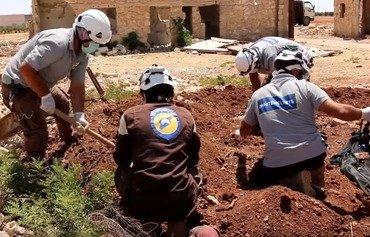 کشف گور اجساد زندانیان با غل و زنجیر داعش در حلب