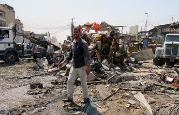 مقتل 11 في انفجار سيارة مفخخة في سوق ببغداد