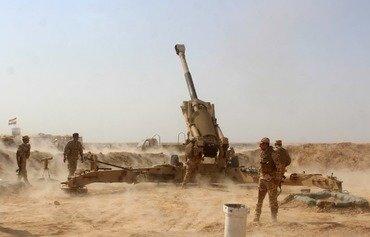 Hêzên Iraqî gundekî li yek ji asêgehên dawî yên DAIŞ kontrol dikin