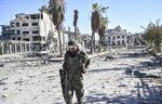 Security forces comb al-Raqa after ISIS ouster