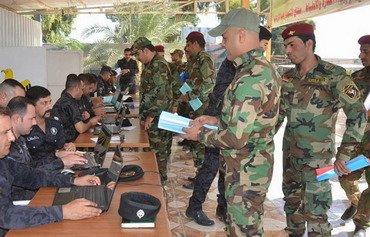 Réintégration des policiers révoqués en Irak