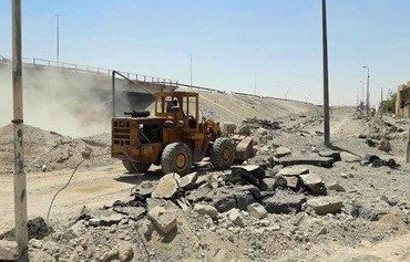 Iraq works to restore damaged Mosul bridges
