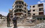 المعارضة السورية تنسحب من الغوطة مع مغادرة أحد زعمائها الكبار من الجيب