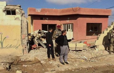 Fallujah homeowners begin to receive compensation