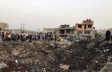 20 قتيلا على الأقل في انفجار مستودع أسلحة في بغداد