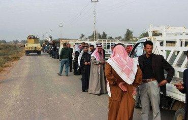 Les habitants déplacés reviennent dans le district d'al-Karma dans l'Anbar