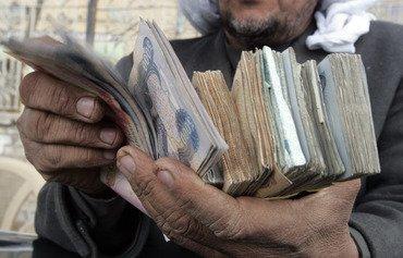 غارات التحالف تدمر شبكة تمويل داعش في العراق