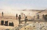 L'artillerie d'Irak et de la coalition pilonne des sites de l'EIIS en Syrie