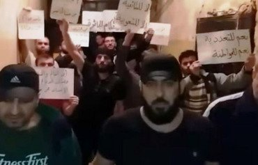 A leaked photo from inside Hama Central Prison shows a protest staged by inmates in protest against the sentences handed down to some of them. [Photo courtesy of Faisal al-Ahmad]