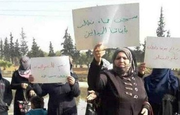 Mothers of Hama prison inmates stage a demonstration in front of the prison in support of their sons. [Photo courtesy of Faisal al-Ahmad]