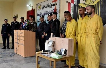 Anbar police commander Hadi Kassar Erzaij announces the arrest of an ISIS sleeper cell in Fallujah during a November press conference. [Photo courtesy of the Anbar police]