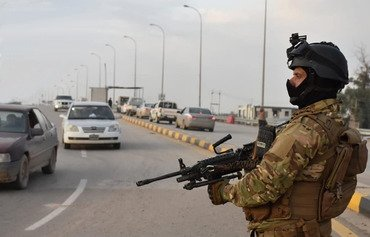 An Iraqi soldier patrols a street in Anbar province. [Photo courtesy of the Anbar police]