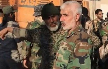 IRGC commander Brig. Gen. Javad Ghaffari, who oversees all militias Iran has formed to fight on its behalf in Syria, is seen among elements of his militias in Aleppo. [Photo courtesy of Jamil al-Abed]