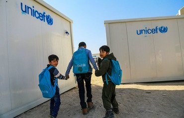 Schoolboys head to class in Fallujah. Iraq is facing a national shortage of school buildings. [Photo courtesy of UNICEF]