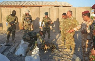 Iraqi forces zero in on ISIS's Anbar arsenals