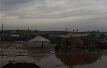 The residents of this flooded displacement camp near the town of Saraqeb have been receiving no humanitarian assistance. [Photo courtesy of Haisam al-Idlibi]