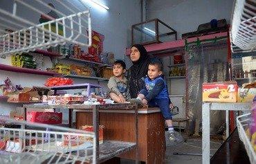 بحكم الضرورة أو التصميم، نساء عراقيات يؤسسن شركات في الموصل