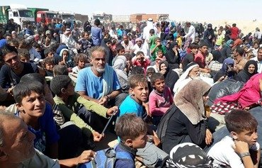 Iraq to repatriate all citizens who fled to Syria
