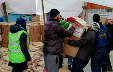 IRGC hands out aid to Syrians as Iranians suffer flooding aftermath