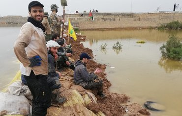 Foreign militias stir tensions in Iran flood aftermath