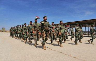 العراق يعيد 55 ألف عسكري سابق للخدمة