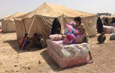 Iraqi forces evacuate families from Fallujah