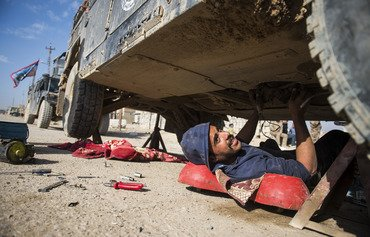 Mosul mechanics fight ISIL with wrenches