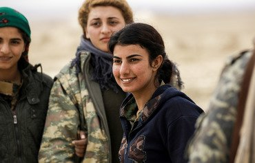 Syrian Arab women battle ISIL, social stigma