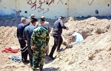 Forensic teams investigate mass graves in al-Rutbah