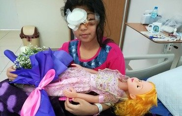 Shot in the face by ISIS, Mosul girl becomes symbol of unity