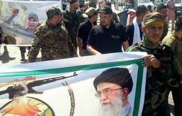 Iran-backed militia publicly marches in Syria, angering locals