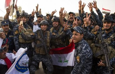 Iraqis celebrate 'historic victory' over terrorism in Mosul