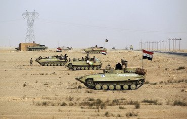 Iraqi forces seize Syria border post from ISIS