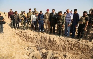 Iraqi forces uncover 3 ISIS mass graves near al-Hawija