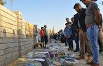Booksellers line Mosul street where ISIS held executions