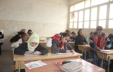 Al-Raqa children sit exams for first time since ISIS expulsion